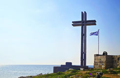 Christian wooden cross and the greek flag Piraeus Greece Royalty Free Stock Photo