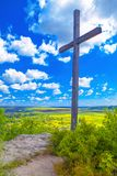 Wooden cross. Christian wooden cross on the top of the hill royalty free stock photo