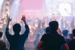Christian worship at church. Christian worship with raised hand,music concert,youth pray to God at church Stock Photo