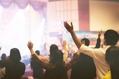 Christian worship at church. Christian worship with raised hand,music concert,youth pray to God at church royalty free stock photography