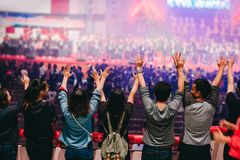 Hands people raised up worship to God. Christian worship with raised hand,music concert,youth pray to God at church royalty free stock photo
