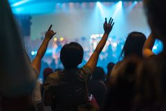 Worship night. Christian worship with raised hand and pray in the worship concert Royalty Free Stock Photo