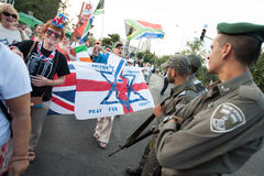 Christian Zionists in Jerusalem. Christian Zionists from the UK offer blessings to Israeli border police during the annual Jerusalem March, October 4, 2012 royalty free stock images
