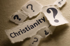 Christianity. Picture of a word christianity with question marks royalty free stock photo