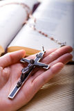 Christianity. Christian believer holding old cross in hand Royalty Free Stock Photos