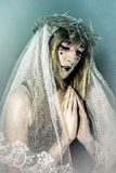 Christianity, aith concept, woman dressed in white veil and crow Stock Images