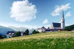 Christianity churh in Gosau village at sunny day. Alps, Austria, Europe. Landscape photography Royalty Free Stock Image