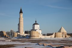 Bolgar, Tatarstan. Christianity and Islam together. Big Minaret Complex and Assumtion Church in ruins. Christianity and Islam together. Big Minaret Complex and royalty free stock images
