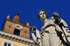 Christianity and Paganism in Rome. Pagan goddess statue and Christian church bell tower from People`s Square in Rome Stock Photography