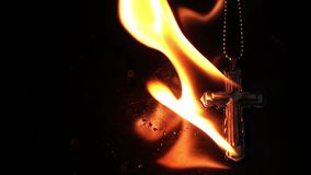 Christianity Religion Symbol Cross on Fire Burning Hell stock video footage