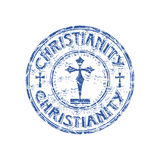 Christianity rubber stamp. Blue grunge rubber stamp with cross symbols and the word Christianity written inside the stamp Stock Photography