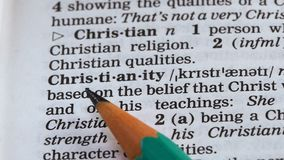 Christianity word definition written in dictionary, one of main religions, faith. Stock footage stock footage