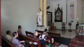 Christians prayer in Ho Chi MInh city stock video