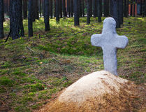 Christians tombstone. Tradition christians tombstone on the grave in the old cemetery. Fresh mound with a stone cross on the edge of the forest Stock Photography