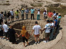 Christians worship around the ancient Arad well in the Judean desert in Israel Stock Photo