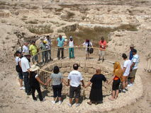 Christians worship around the ancient Arad well in the Judean desert in Israel Stock Images