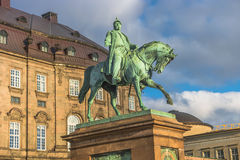 Christiansborg Palace and statue of Christian IX illuminated in Royalty Free Stock Photography