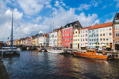 Christianshavn harbor in Copenhagen, Denmark - September, 24th, 2015. Colorful scandinavian houses and private boats reflected on Stock Photography