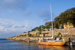 Christianso Island harbor with yacht. In a sunny day with blue sky Stock Image