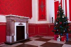 Christimas inre i rött tappningrum Royaltyfri Fotografi