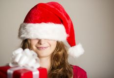 Christimas suprise. Beautiful smiling woman opening her christmas gift Stock Image