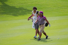 Christina Kim with her caddy at LPGA Malaysia Royalty Free Stock Image