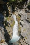 Christine falls surges through a narrow canyon. In Mount Rainier National Park Royalty Free Stock Photos