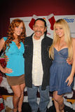 Christine Smith, Danny Trejo and Heather Renee Smith. At Bridgetta Tomarchio B-Day Bash and Babes in Toyland Toy Drive, Lucky Strike, Hollywood, CA. 12-04-09 stock photography