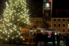Christkindlmarkt Altötting. The lights on a christmas tree shine bright at the Christmas Market in from City Hall in Altötting, Germany Stock Photos
