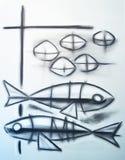 Christliches Symbol von zwei Fischen und von fünf Broten Lizenzfreie Stockfotografie