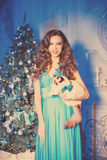 Christmans party, winter holidays woman with cat. New year girl. Christmas tree in interior background Stock Photos