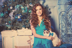 Christmans party, winter holidays woman with cat. New year girl. Royalty Free Stock Photo