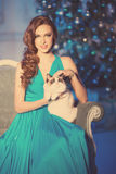 Christmans party, winter holidays woman with cat. New year girl. Christmas tree in interior background Stock Image