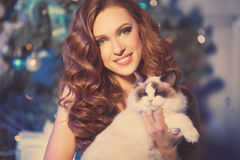 Christmans party, winter holidays woman with cat. New year girl. Royalty Free Stock Photos