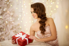 Christmans party, winter holidays woman with gift box. New year. Girl. christmas tree in interior background stock photography