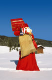Christmas. Time - santa claus with many presents Stock Photo