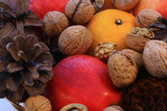 Christmas. Decoration with apple and walnut cone royalty free stock images
