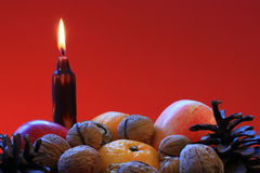 Christmas. Red apple,nut,cone and candle royalty free stock image