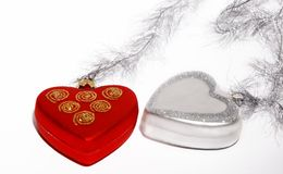 Christmas. Two Christmas heart toys on silver ribbon. Isolated on white background Stock Image
