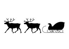 Christmas. Black silhouettes of reindeer and sled Royalty Free Stock Image