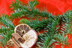 Christmas. Decoration in red and green with dried apple, dried orange slice, cinnamon Stock Photos