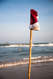 After the Christmas. After the party. Christmas hat and swimming man on background. Christmas collection Royalty Free Stock Images