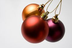 Christmas. Three different colors of christmas ornaments on white background Stock Photos