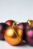Christmas. Red, purple, and yellow christmas ornaments Stock Images