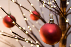 Christmas. Red christmas ornaments hanging from christmas tree Stock Photography