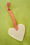 Christmas. Handmade heart Christmas decoration on green background Royalty Free Stock Photography