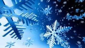 Christmas. Bunch of snowflakes falling with blue background Royalty Free Stock Photos