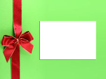 Christmas. Present with red bow and white paper for text or messages. Concept: Christmas present Royalty Free Stock Photo
