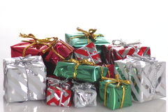 Christmas. A pile of gifts in Christmas wrapping paper isolated against a white background. Shallow depth of field stock image
