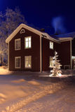 Christmas. An old house in the cold winter night Stock Photos